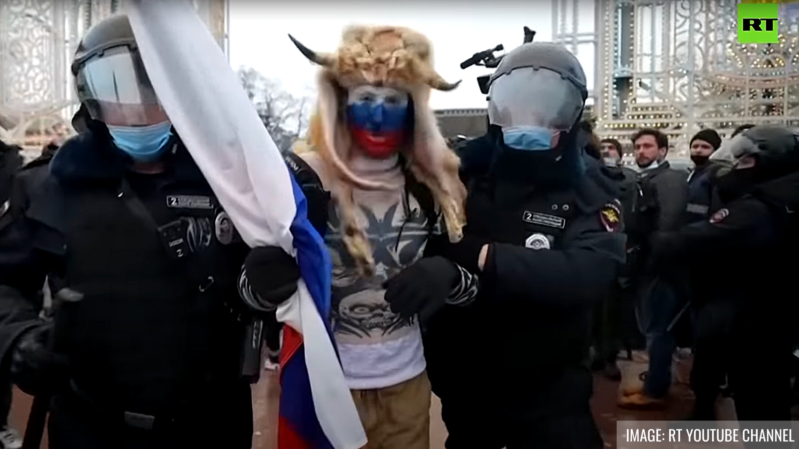 Detained protester in Moscow. Image: RT YouTube channel.